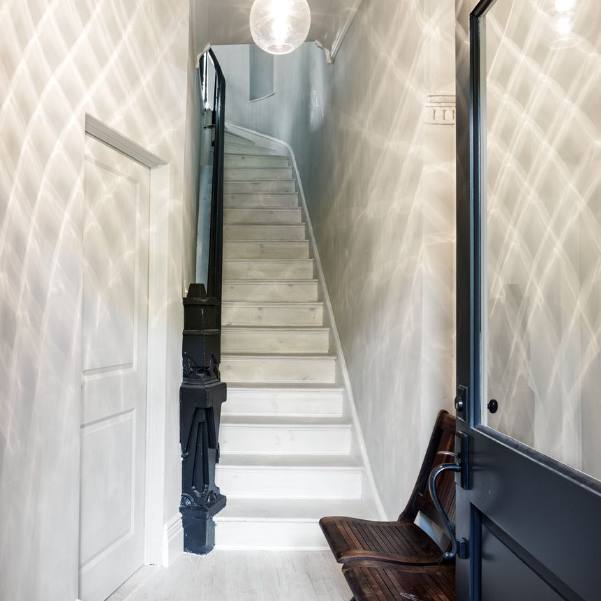 staircase with dramatic lighting