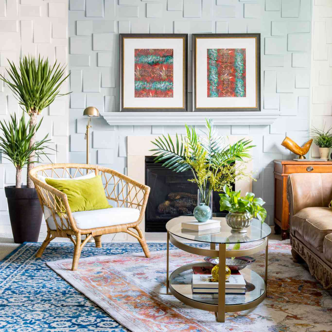 A bohemian living room with red and turquoise art in it