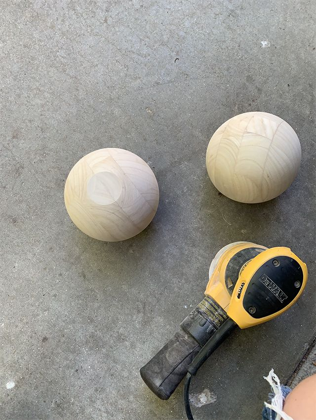 Wooden balls that become legs on media console.