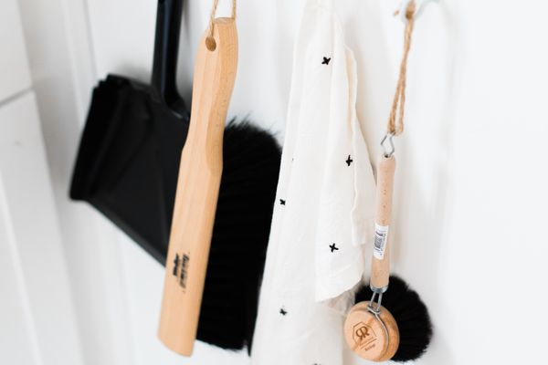 Cleaning tools hang from individual hooks