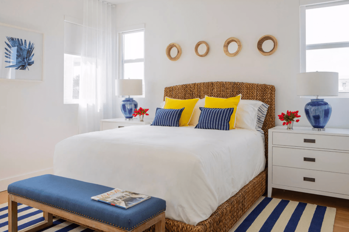 A beachy bedroom with sheer white curtains