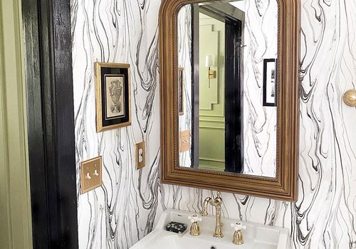 bathroom with brass accents