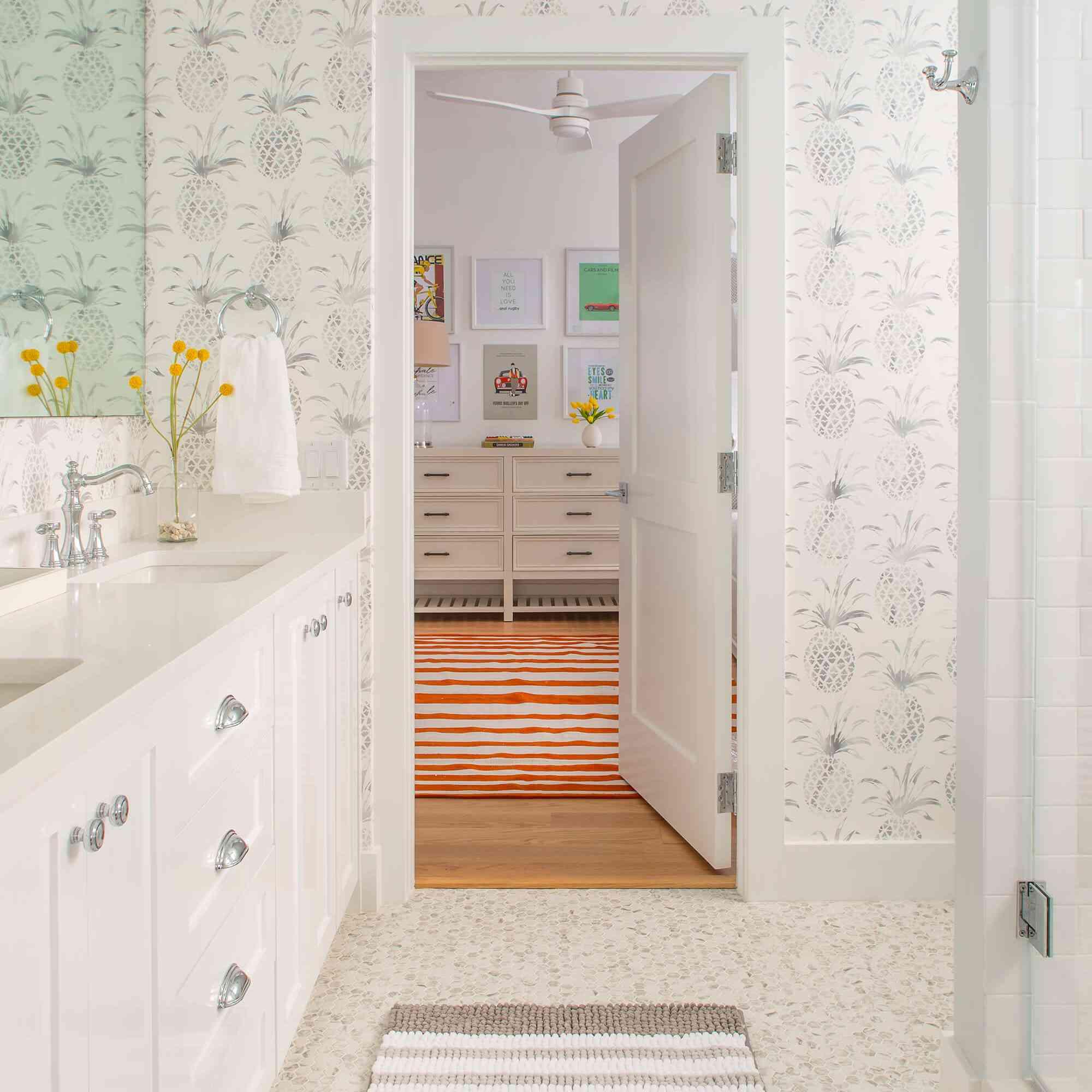 Subtle tropical bathroom with wallpaper