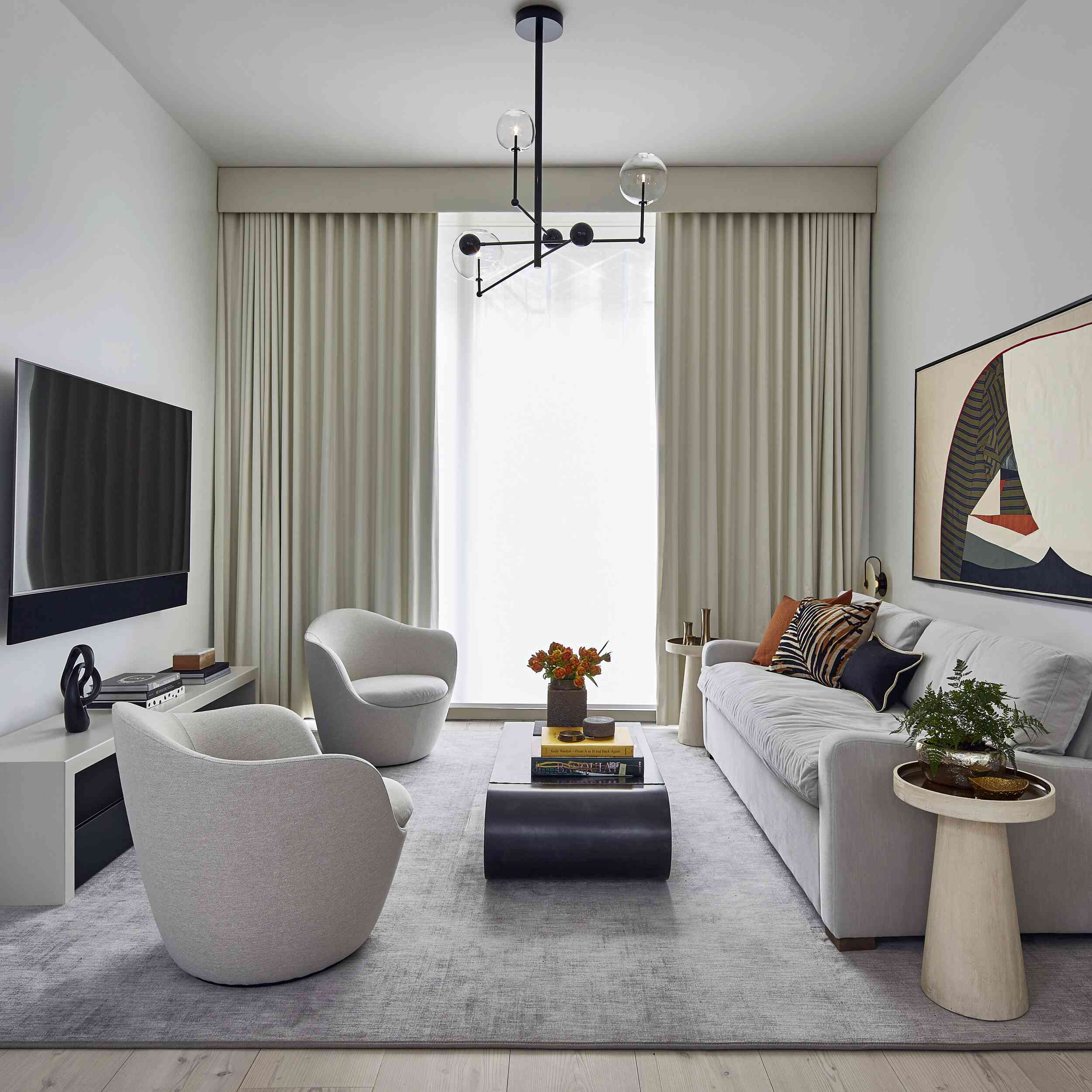 Modern luxe apartment living room with large drapes.