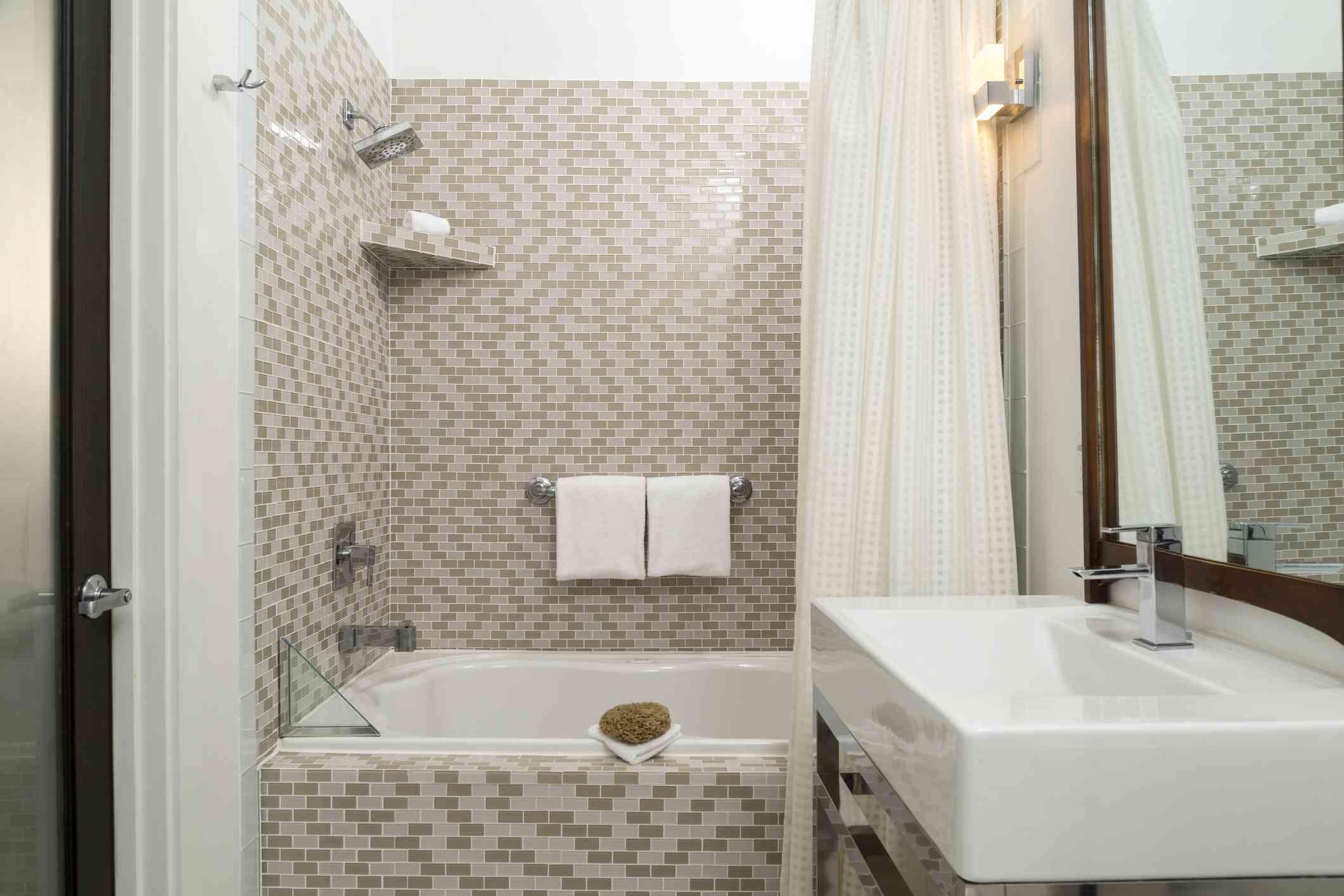 Modern tiled bathroom with sink and vanity