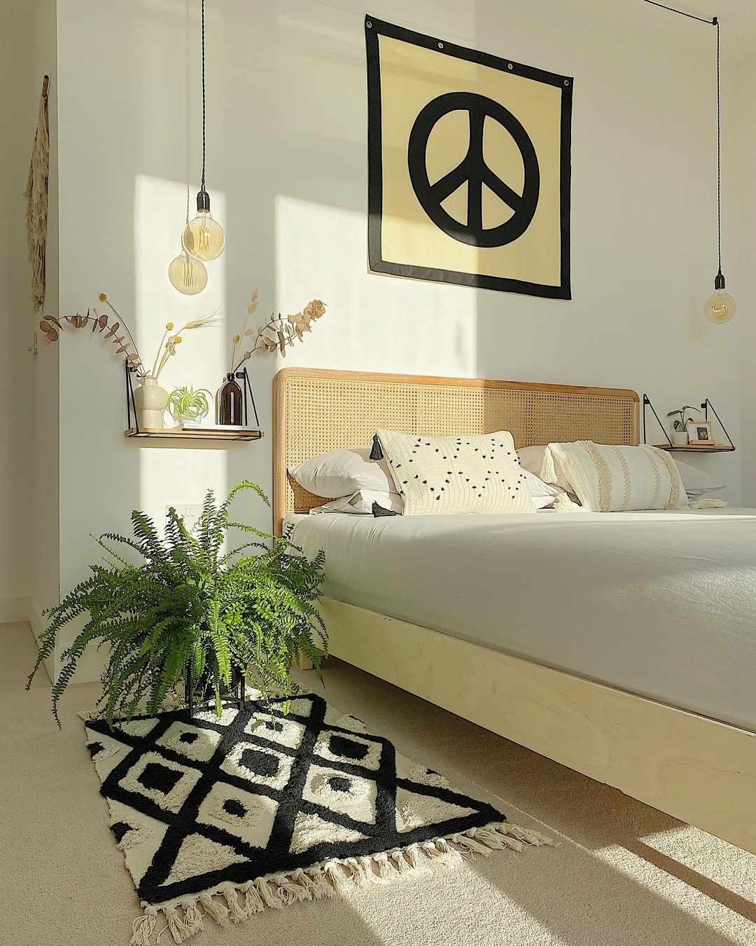 Boho, funky bedroom with peace sign tapestry.