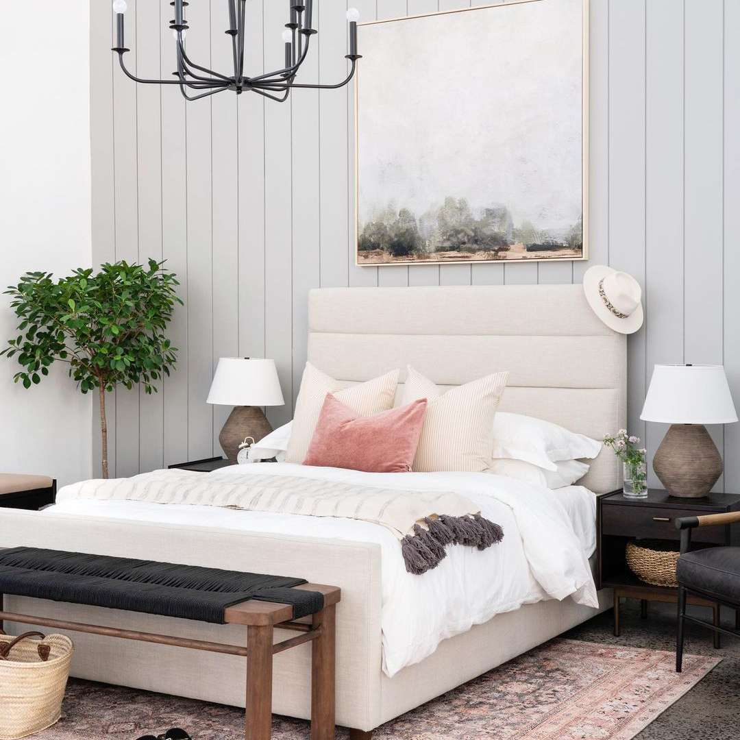 Bedroom with a large print behind it