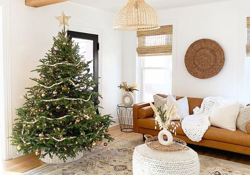 how our editors are spreading cheer - christmas tree in cozy room
