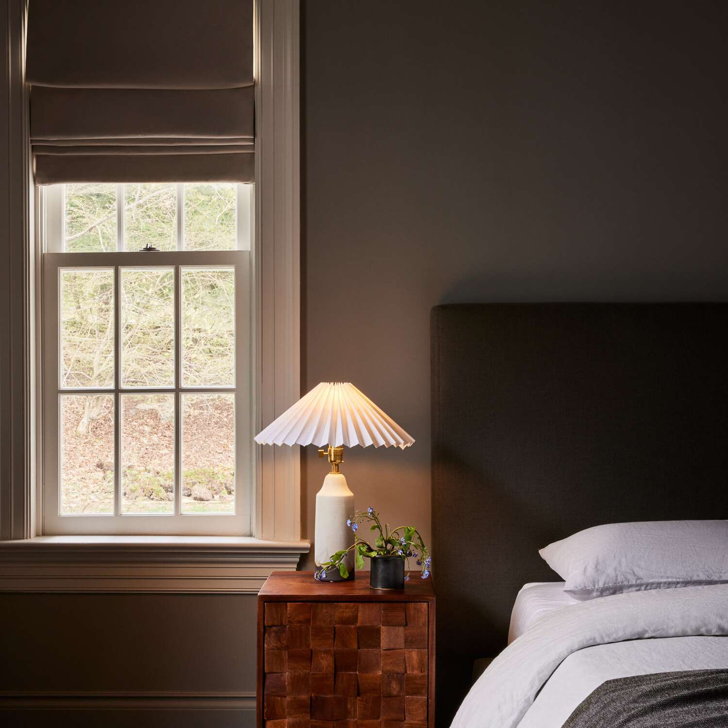 A low-profile bed next to a small nightstand