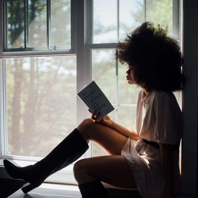 woman reading in window