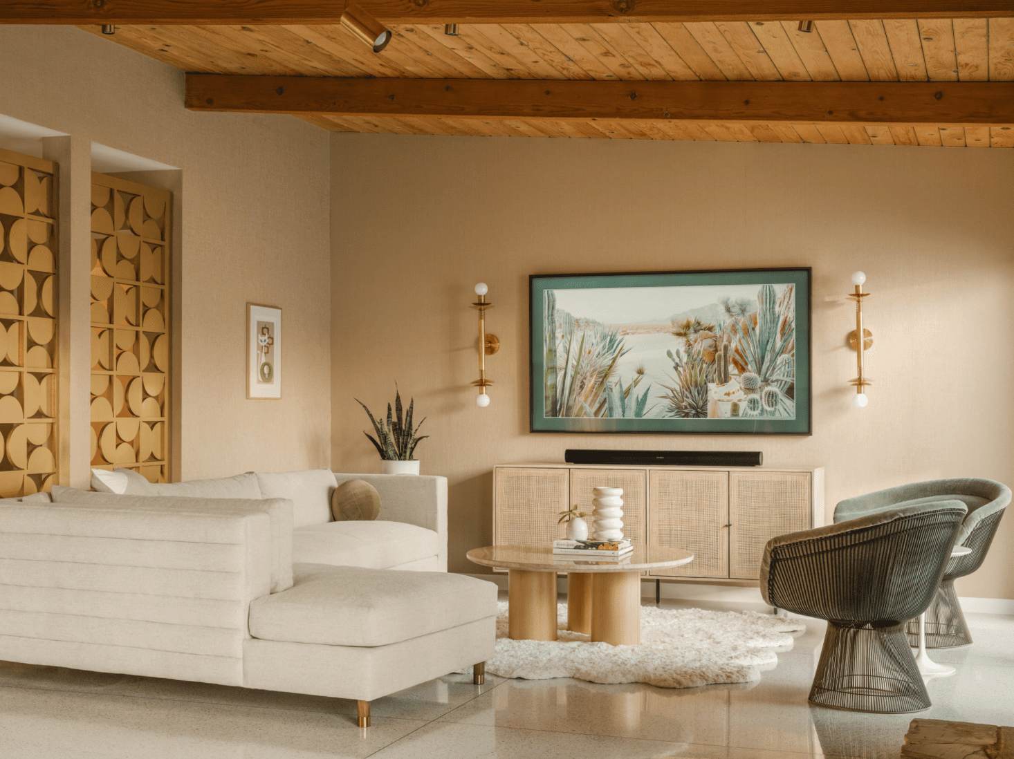 A living room with beige walls and sage furniture