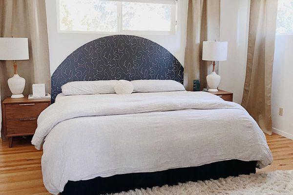 Bedroom with black light fixture