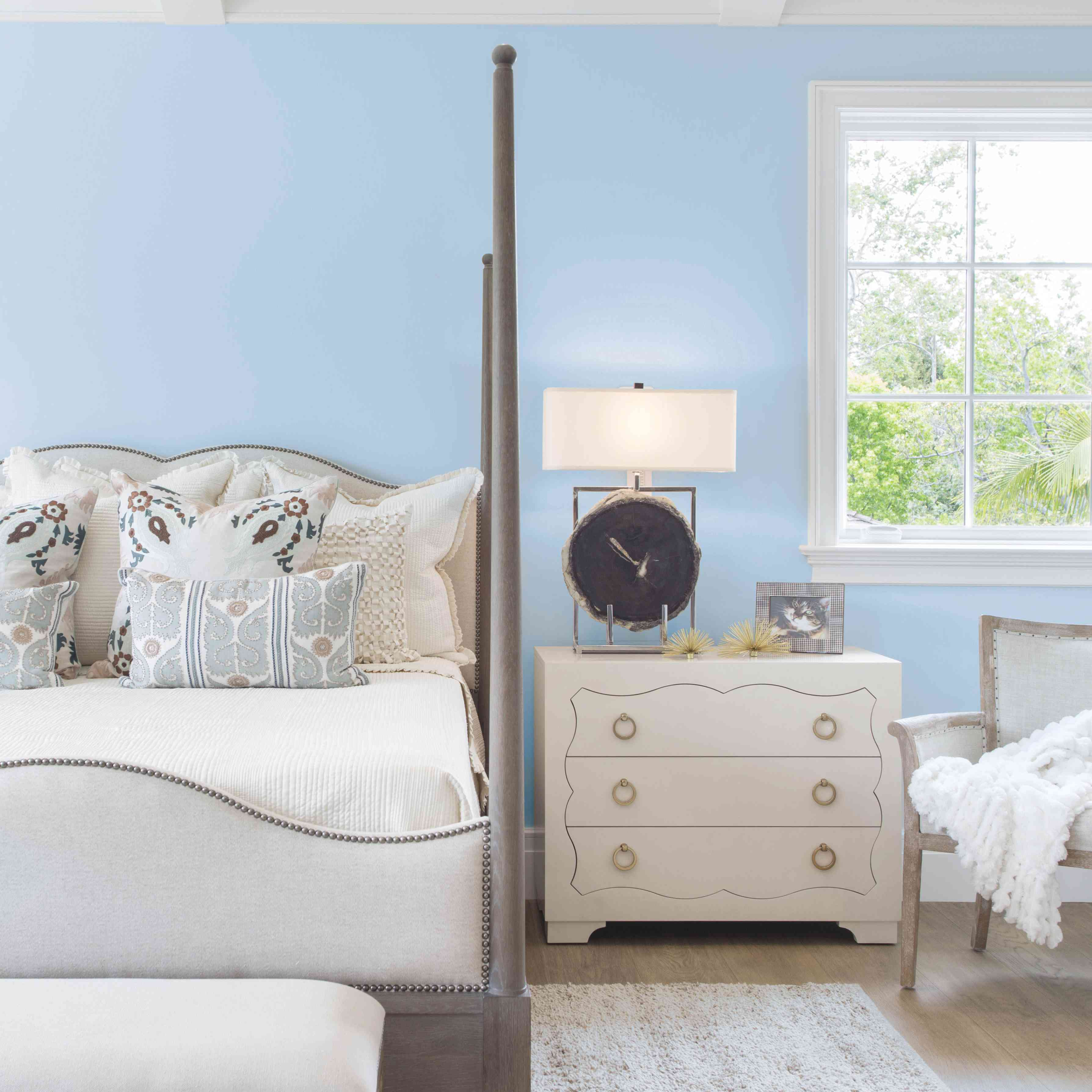 Vintage-inspired bedroom with walls painted Wild Blue Yonder.