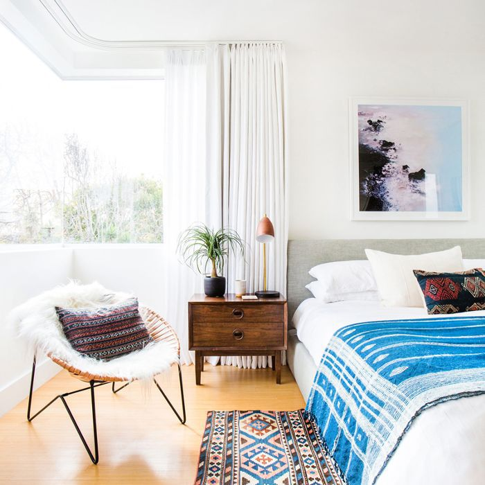 a bedroom with a bedside plant