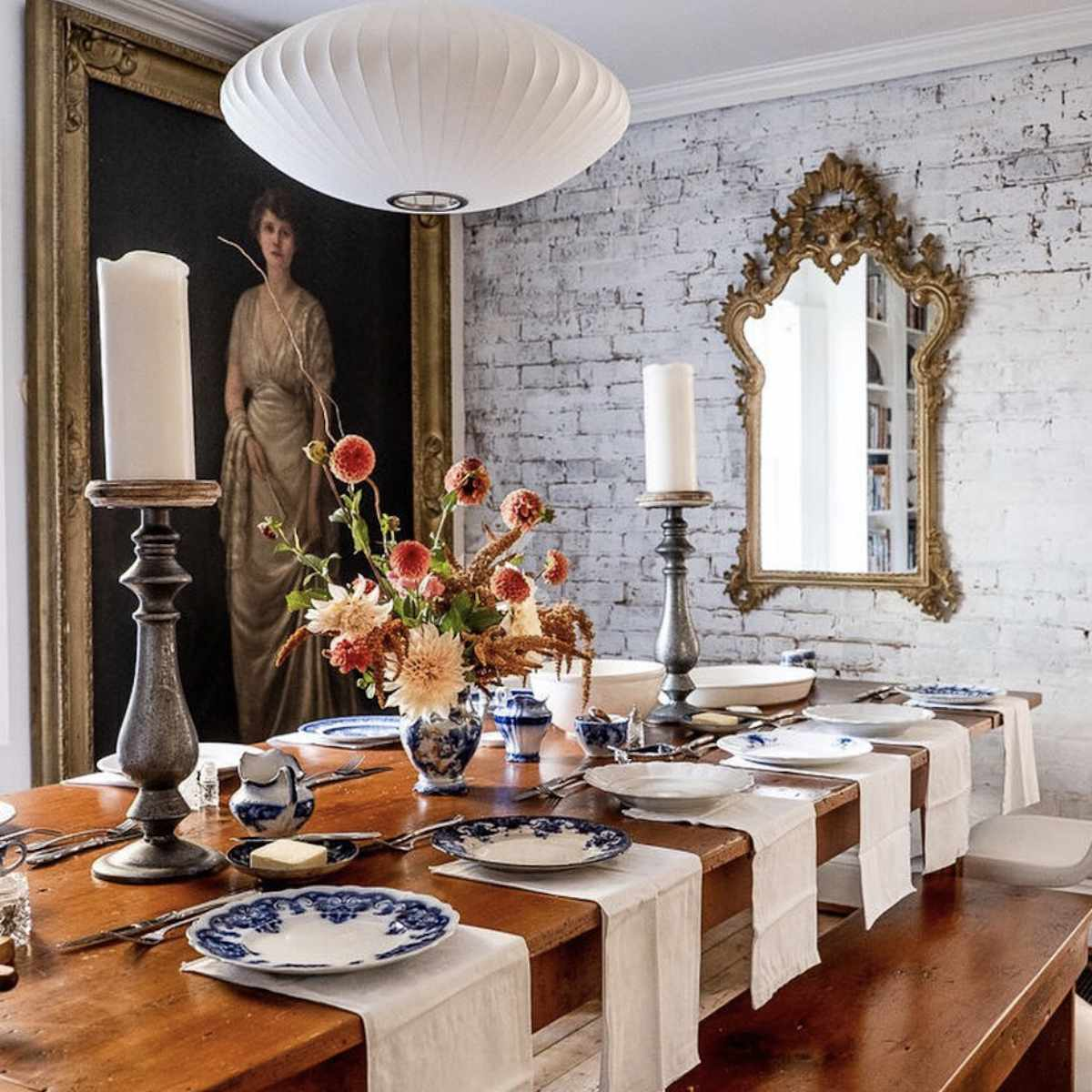 gorgeous white washed brick wall in dining room