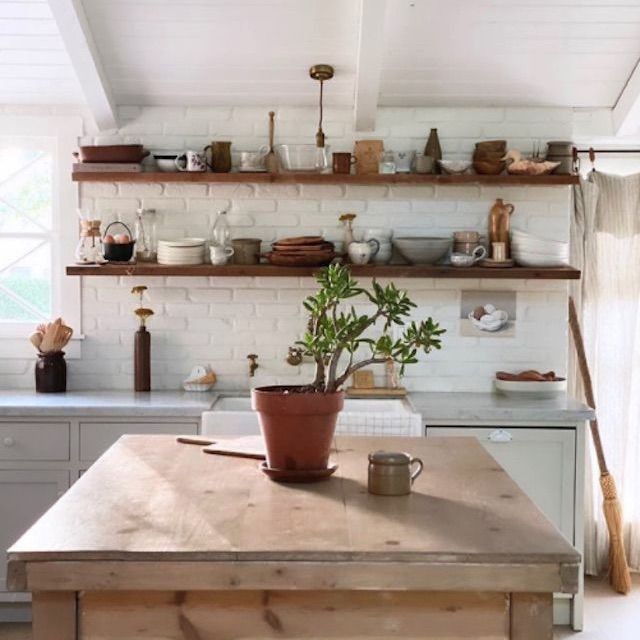 Kitchen with open shelves by Milk and Honey Life
