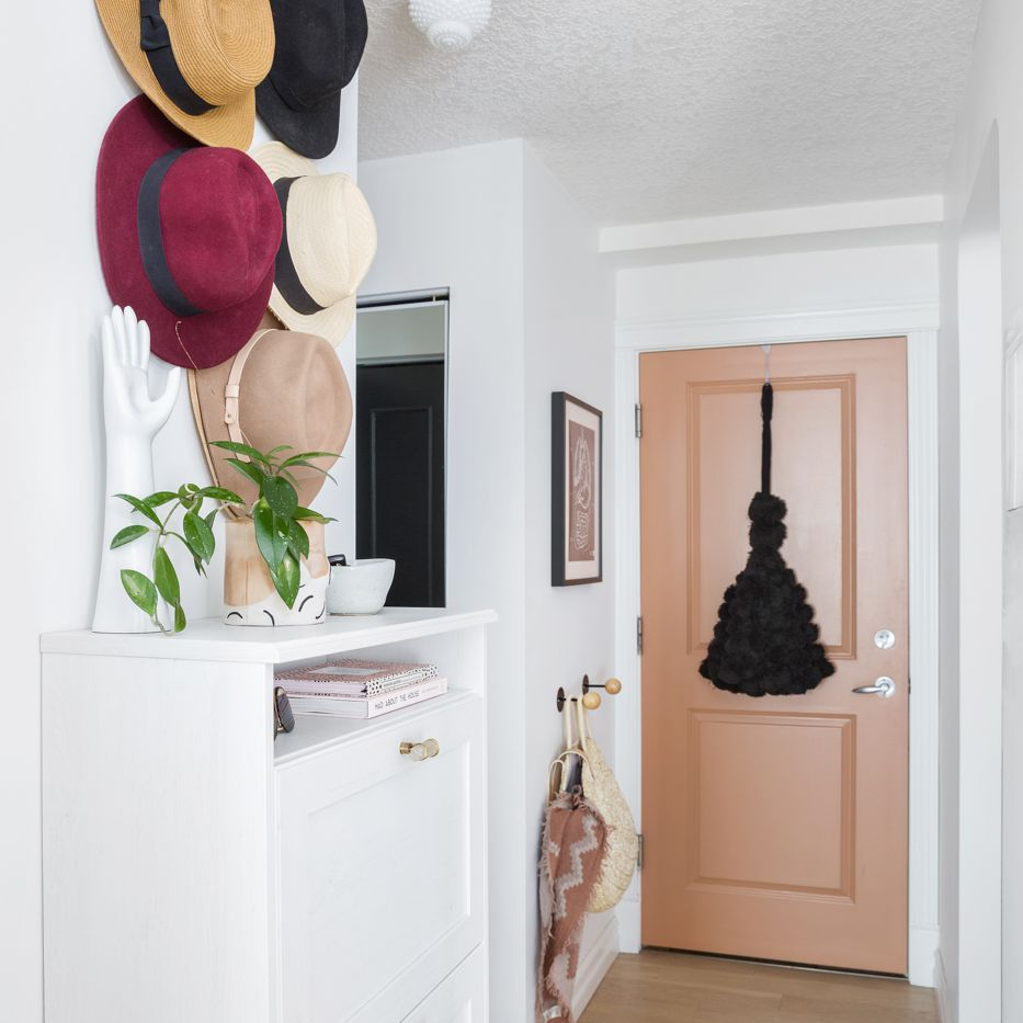 Apartment entryway with small console and hooks