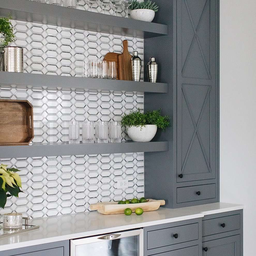 Slate gray cabinets with patterned wallpaper