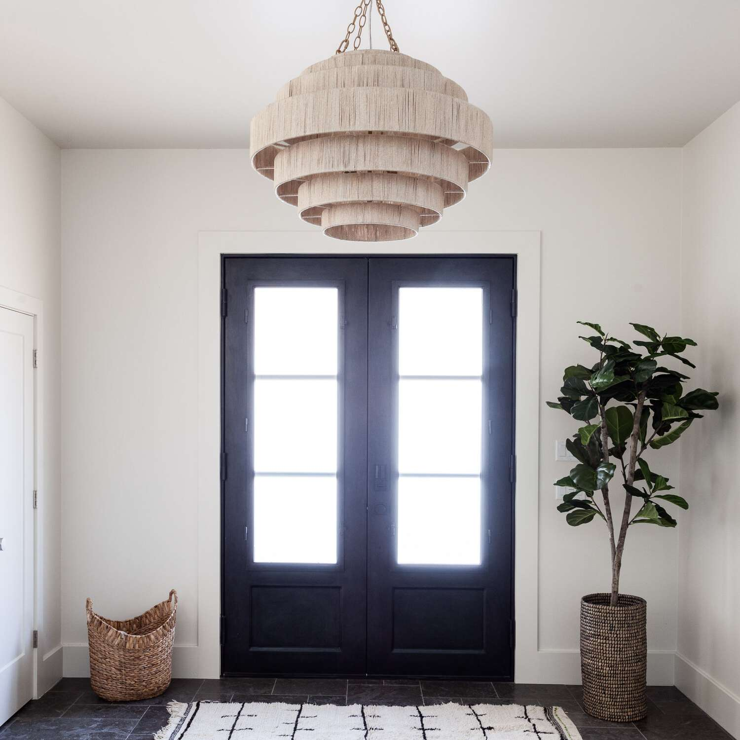 A foyer with a large ivory chandelier