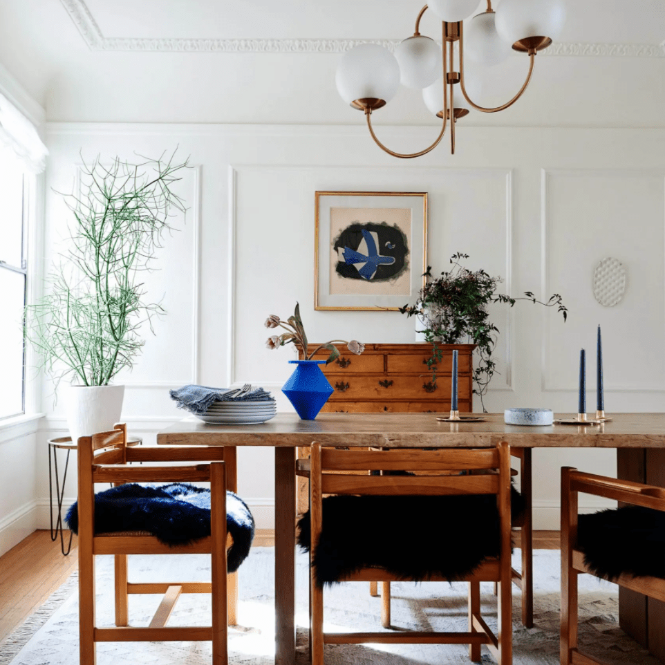 A dining room filled with wooden furniture and adorned with color-coordinated blue decor