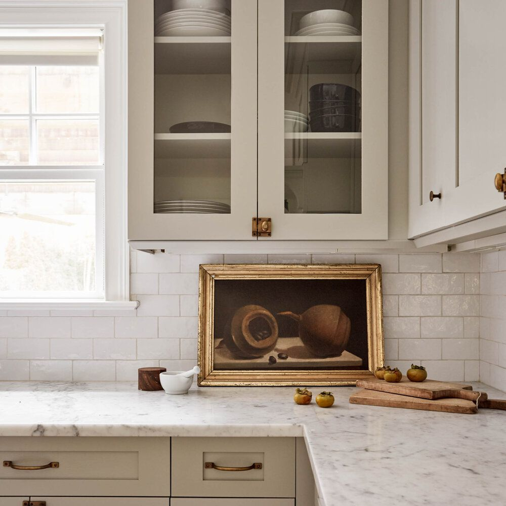 A kitchen with ivory cabinets