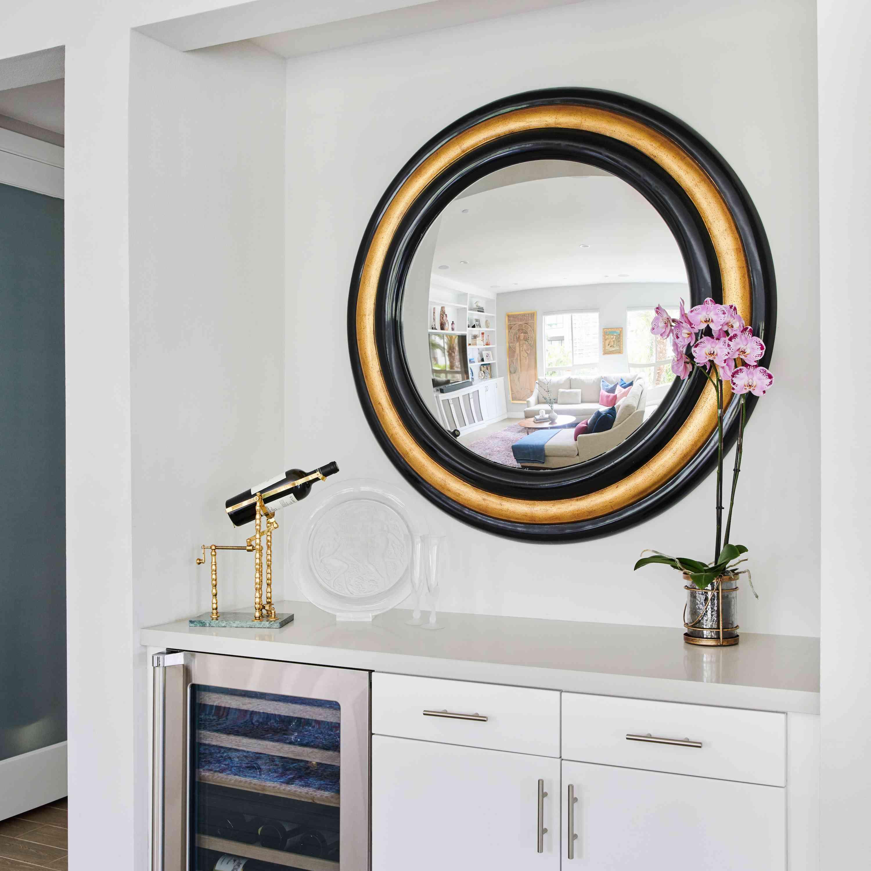 Bar nook with large round mirror.