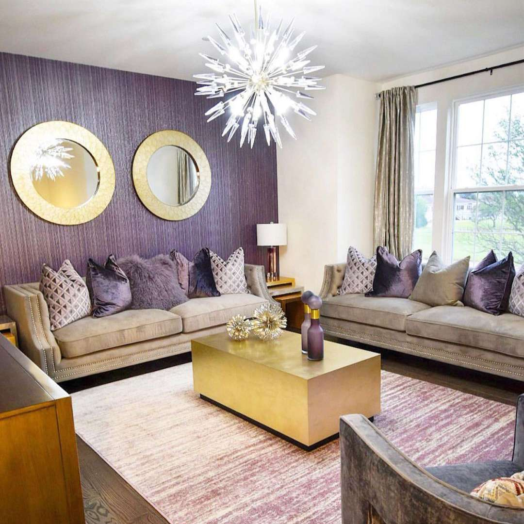 Luxe purple living room with brushed brass accents