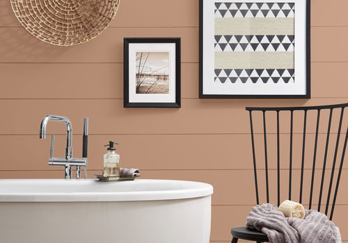 Boho inspired bathroom with large tub and wall painted Canyon Dusk.