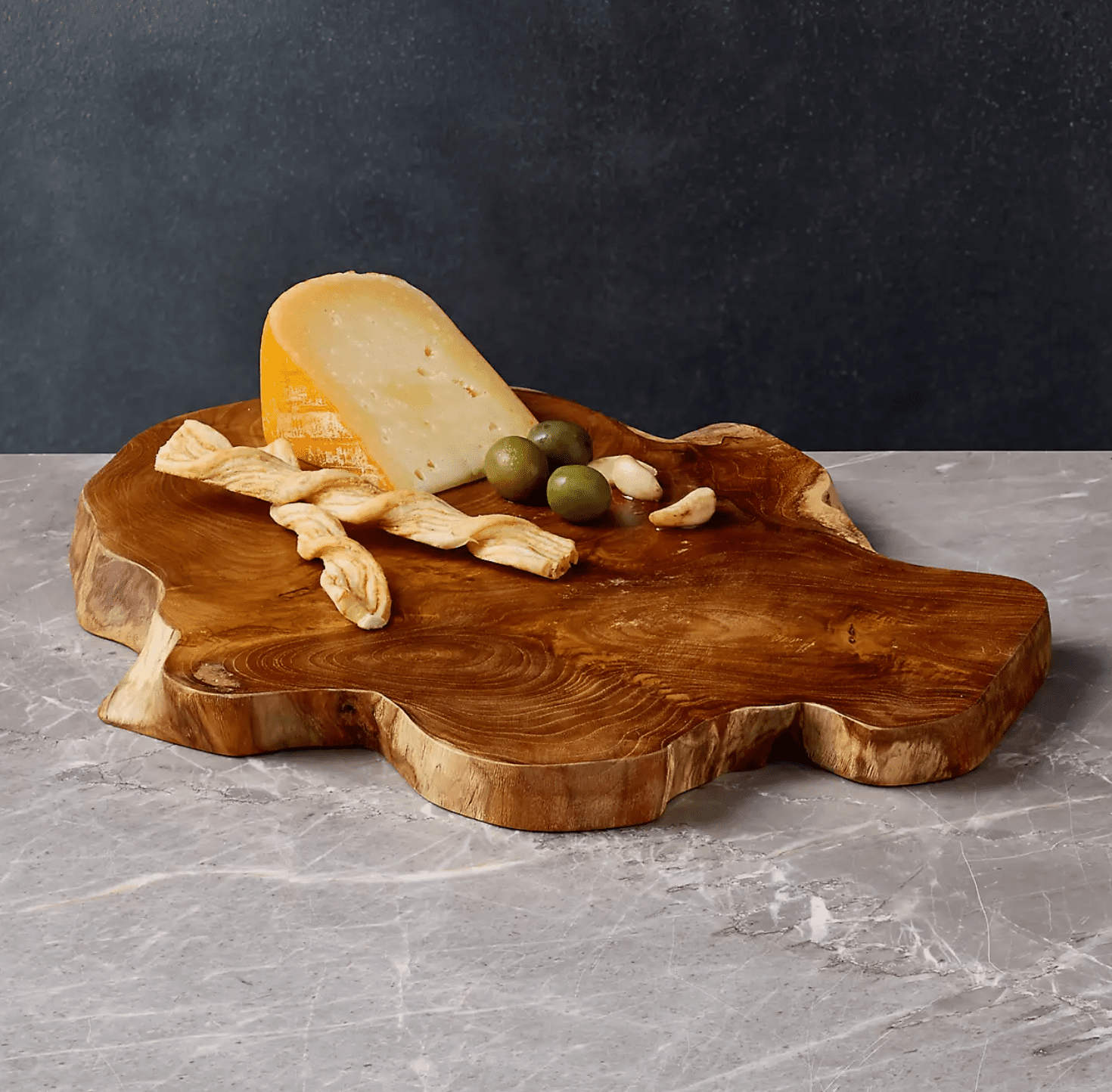 A reclaimed wood cutting board, currently for sale at Crate & Barrel