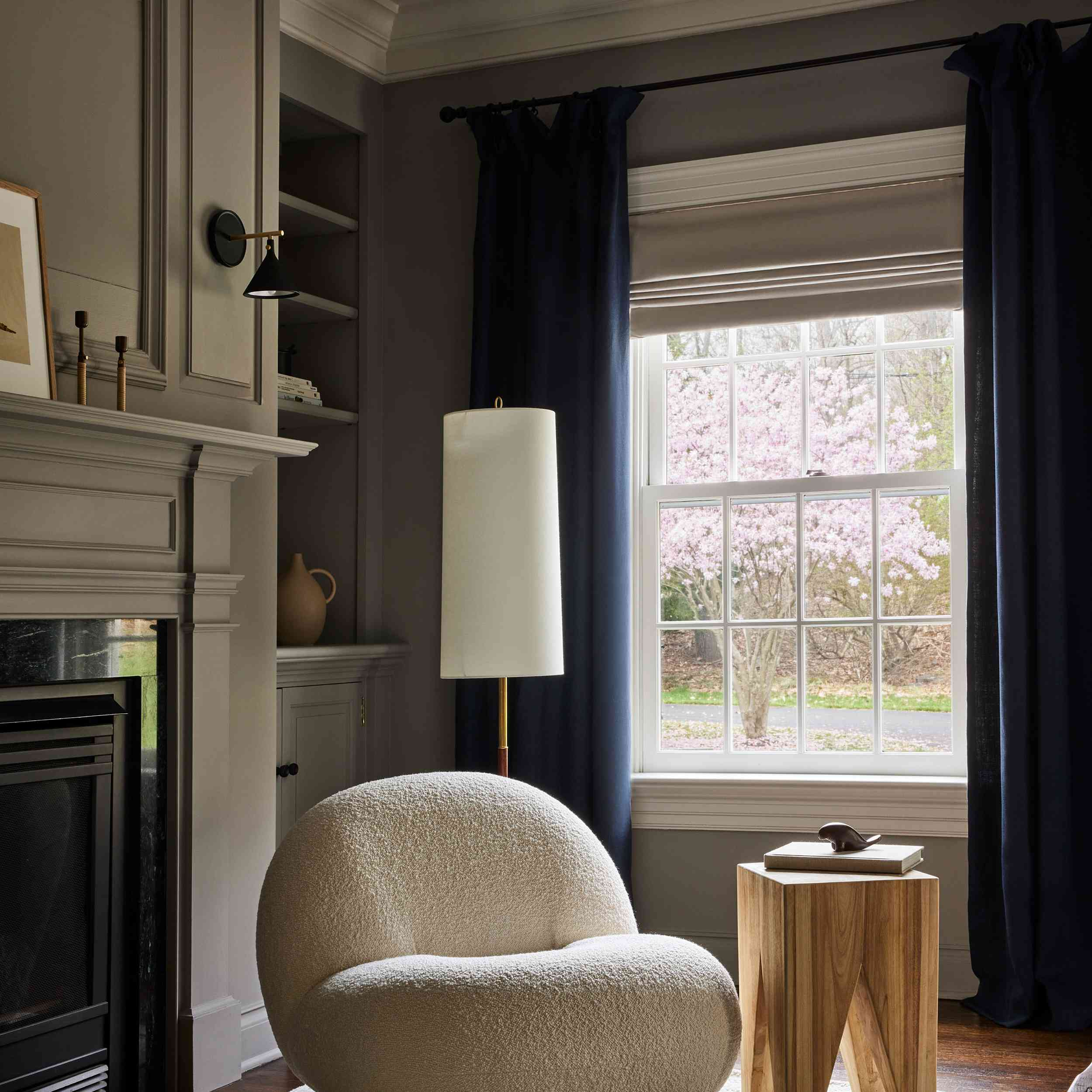 connecticut farmhouse home tour - bedroom with boucle chair and navy curtains
