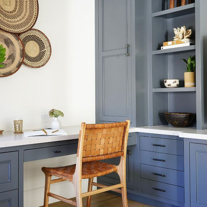 Home office with built-in blue cabinetry
