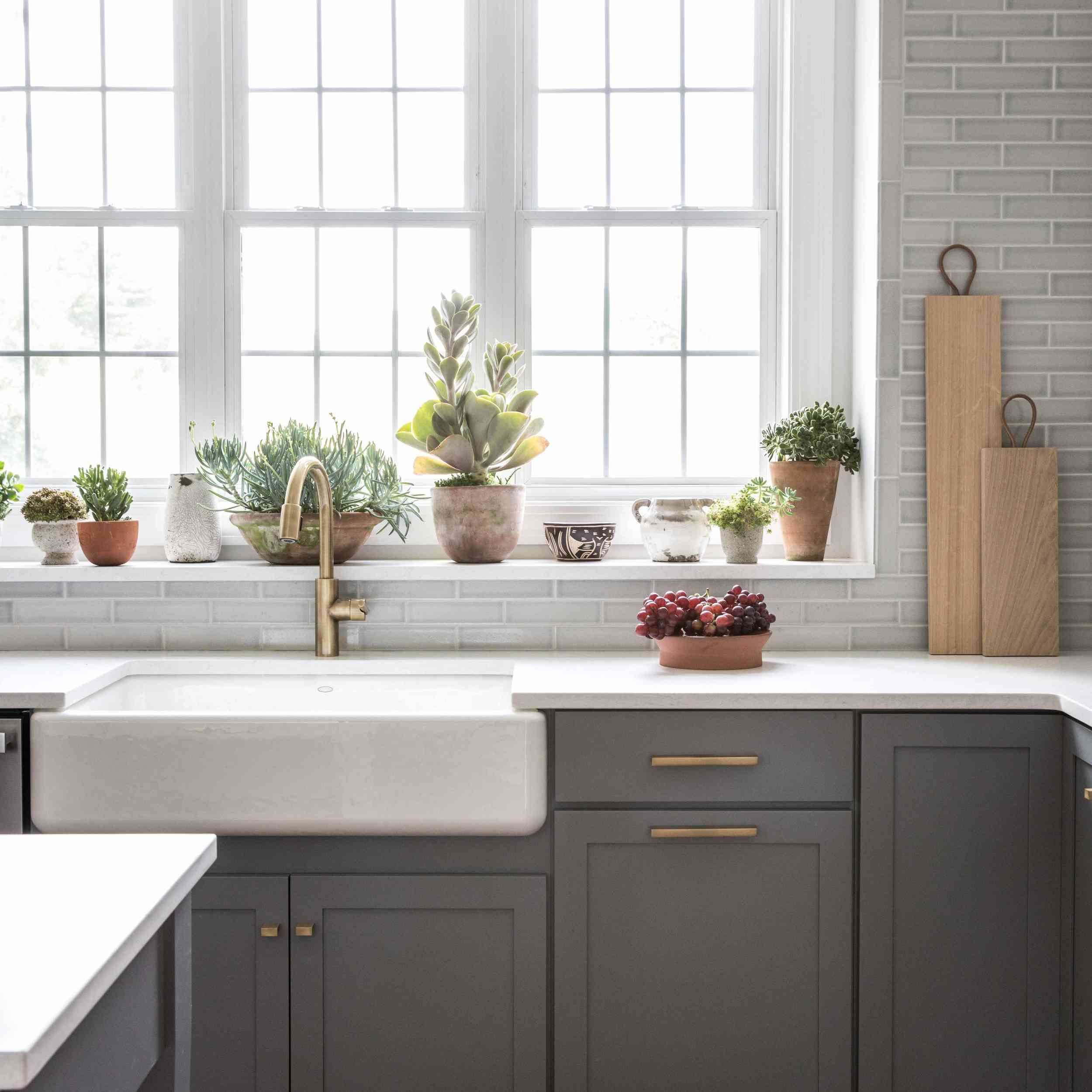 A kitchen with gray cabinets