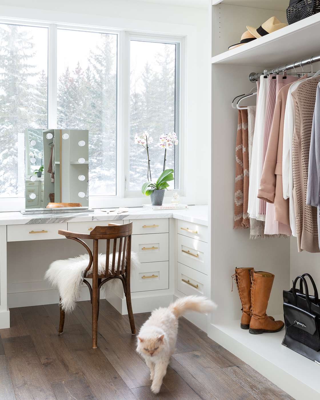 Bright, open closet with a vanity station