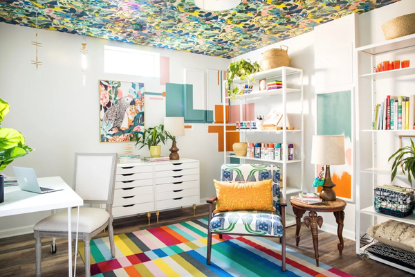 home office with colorful wallpapered ceiling