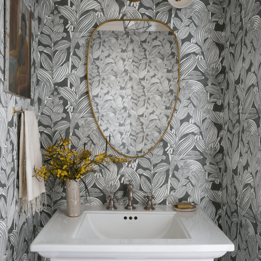A powder room covered in bold wallpaper