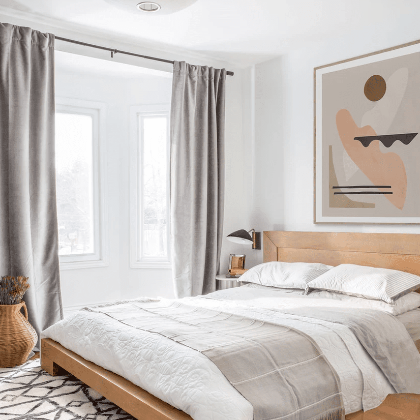 A modern bedroom with a white lantern and sleek black sconce