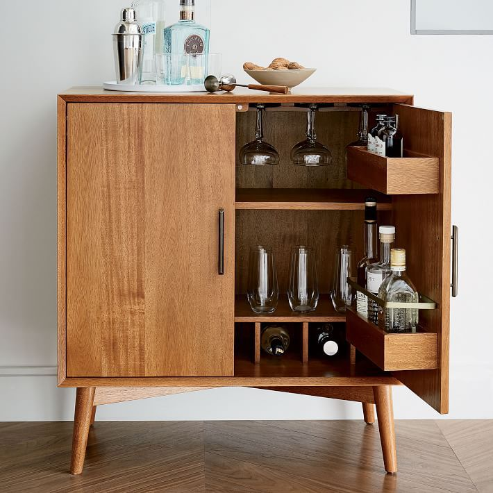 A wooden bar cabinet, currently for sale at West Elm