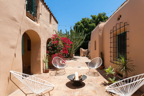 A patio with four sculptural lounge chairs