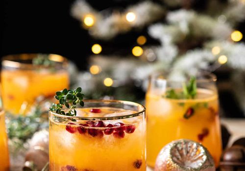 Best Christmas cocktails - Citrus cocktail garnished with pomegranate seeds