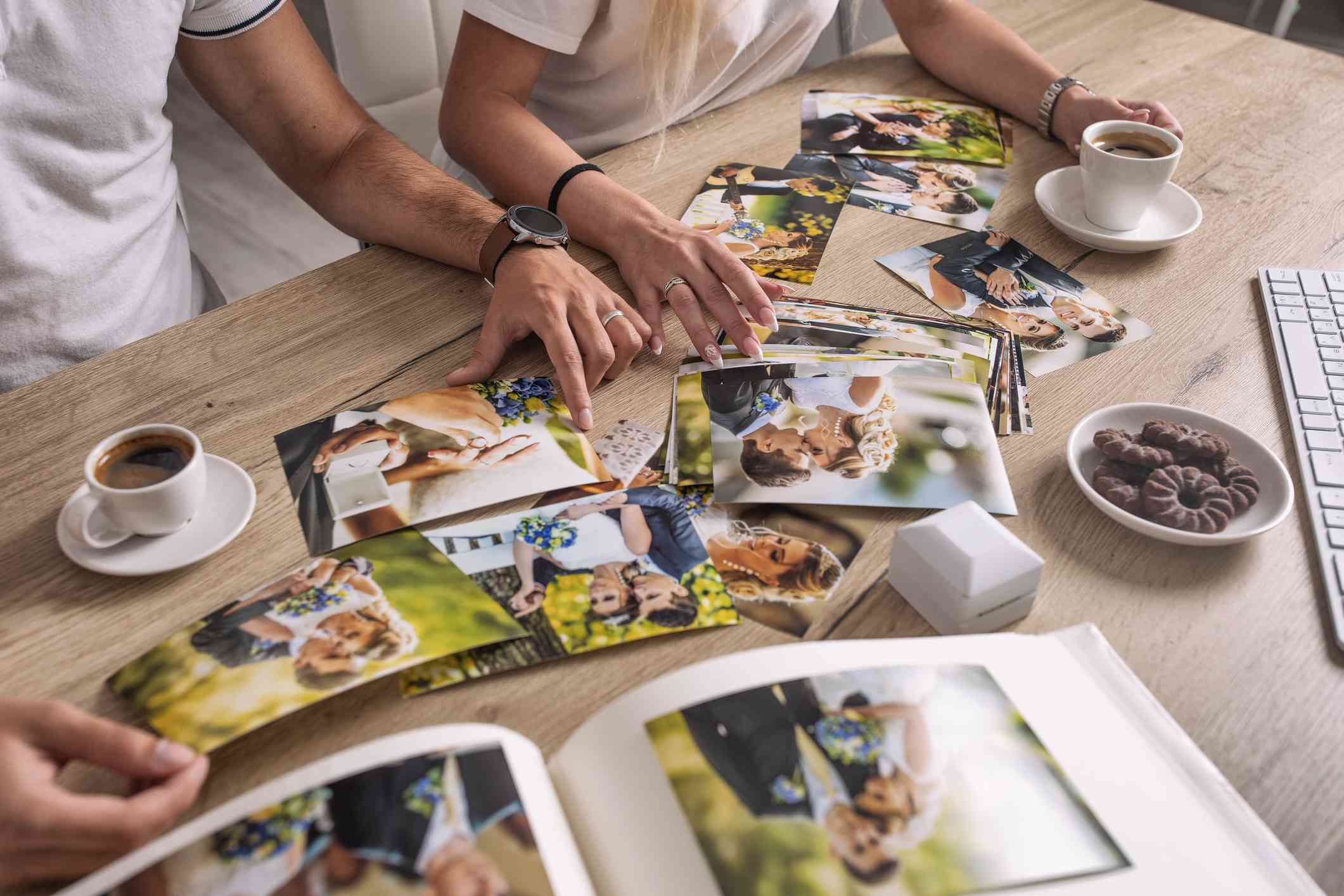 Couple scrapbooking at dining table