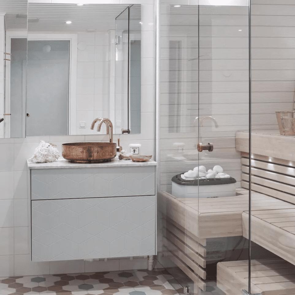 Ceramic tiled bathroom with sauna