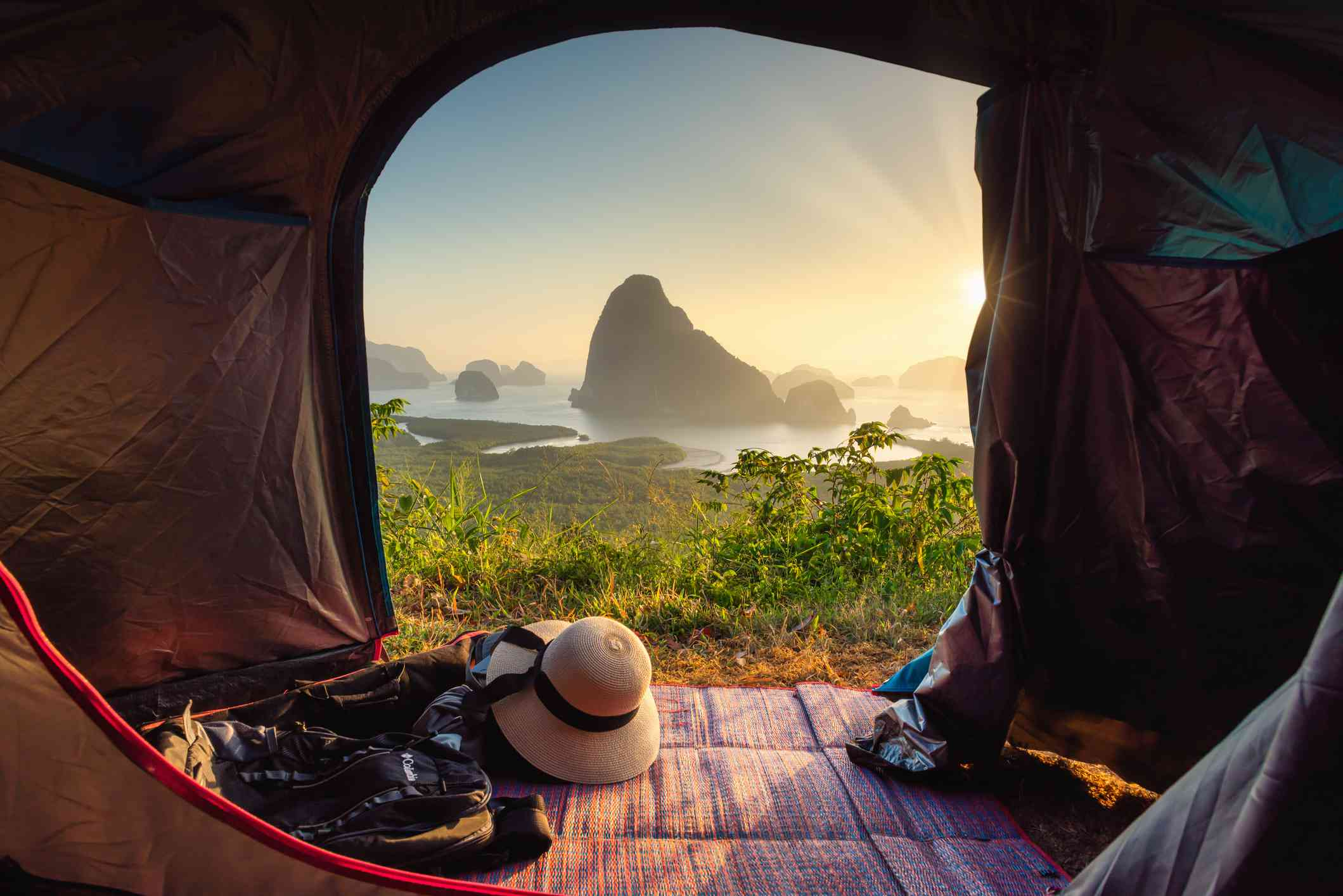 Scenic view of seascape through camping tent