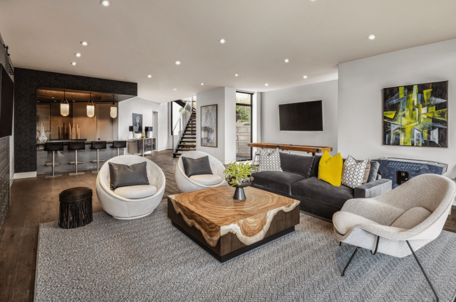 A spacious basement lined with recessed lighting