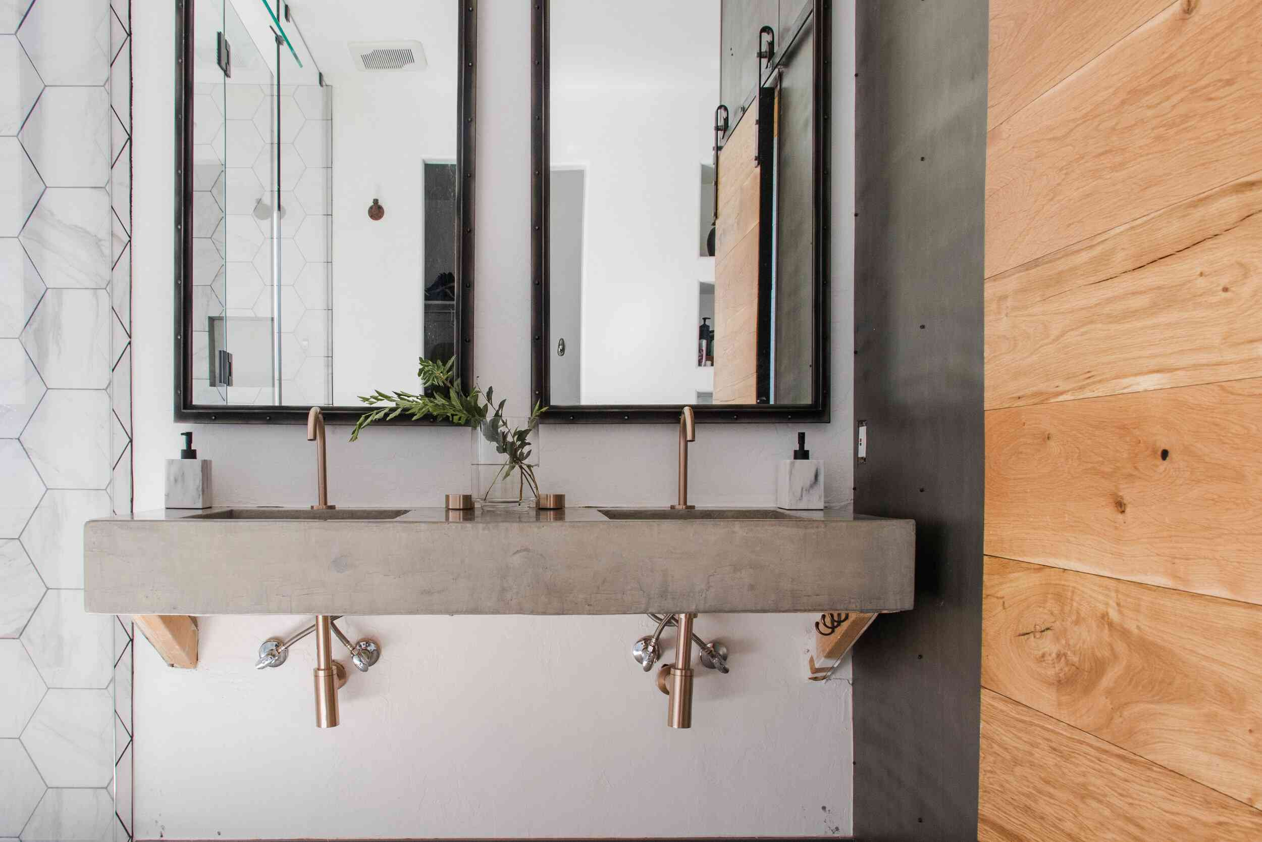 A bathroom with a concrete wall-mounted sink