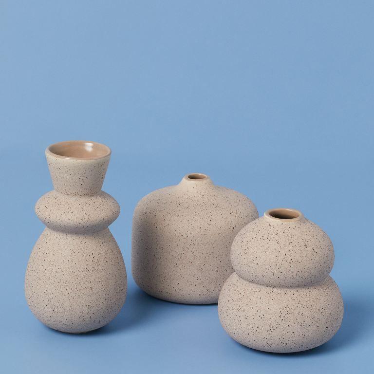 Small stone vase promo photo.