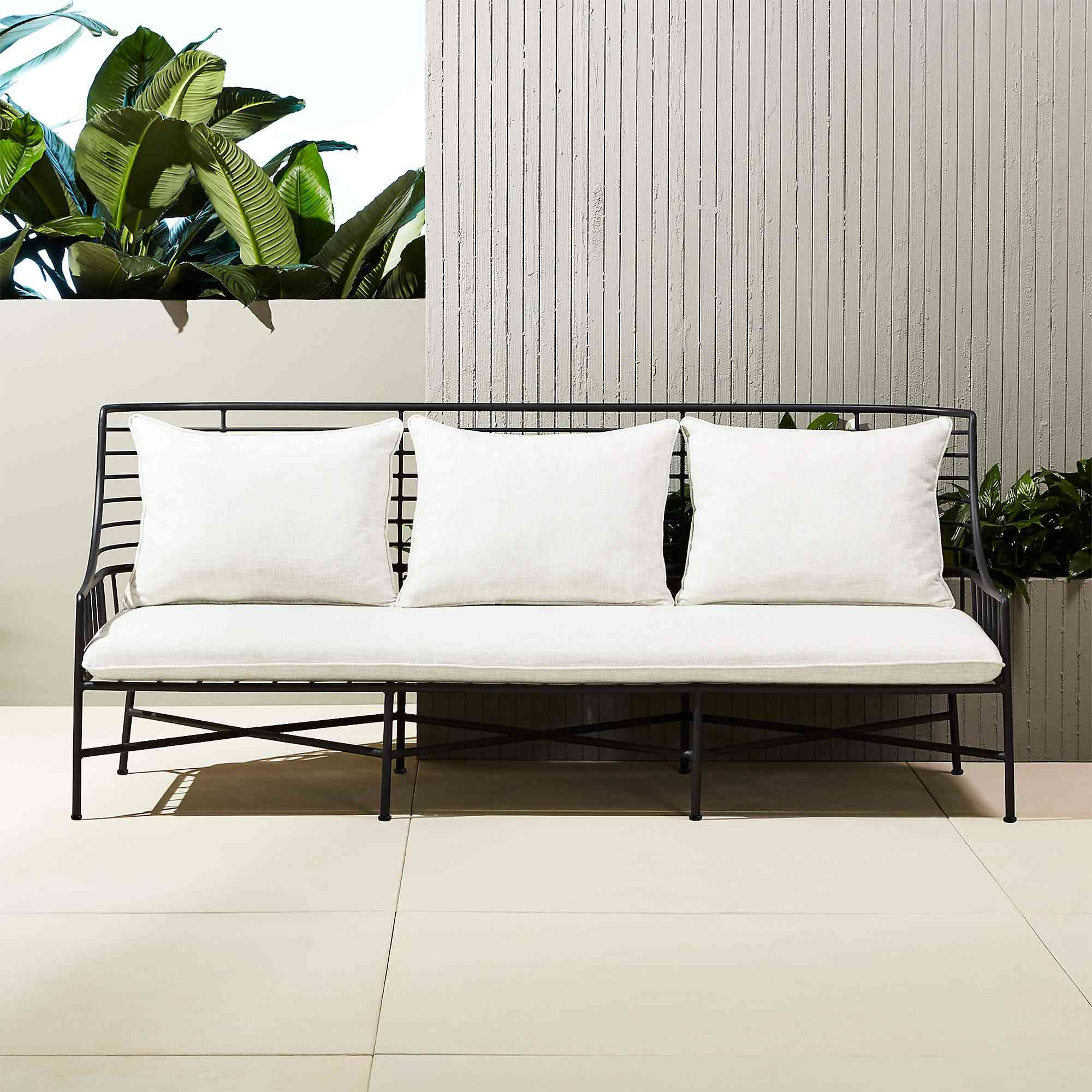 A white and black outdoor sofa, currently for sale at CB2