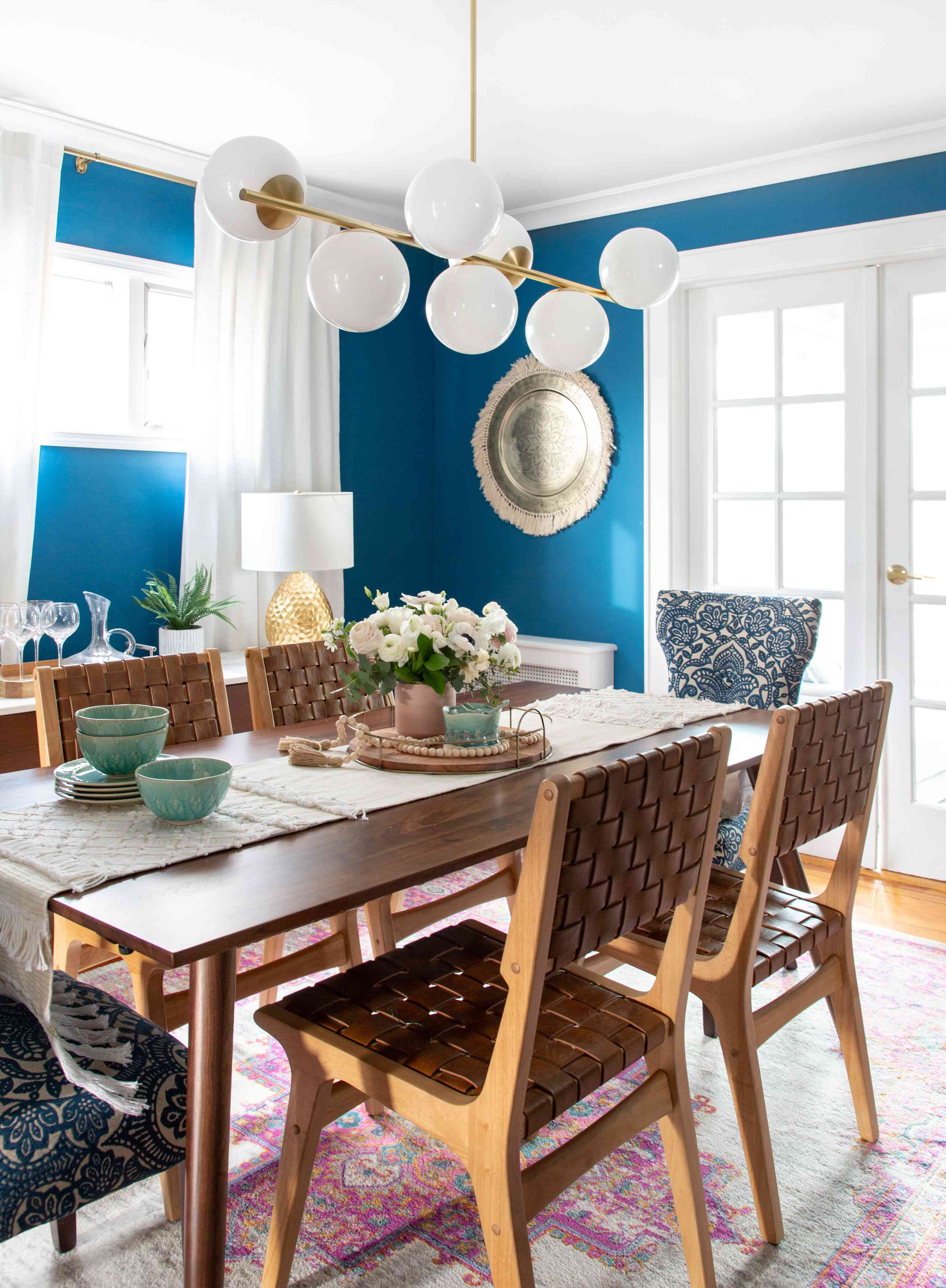Close up of dining room table and chairs.