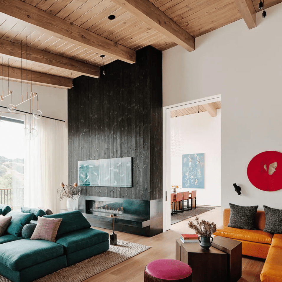 A living room with vaulted wood-lined ceilings