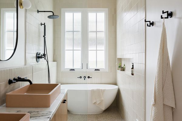 Modern bathroom with cream and peach accents