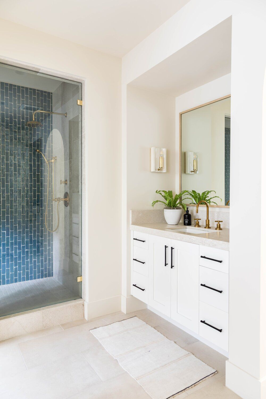 Bathroom with beige tile.